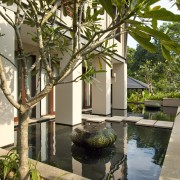 Exterior view which features a fish pond. - arecales, courtyard, estate, home, house, outdoor structure, palm tree, plant, property, real estate, reflecting pool, resort, tree, villa, brown
