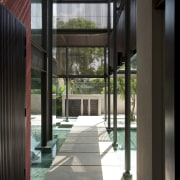 View of reflection pool with granite stepping stones. architecture, door, house, interior design, property, window, black