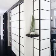 View of kitchen designed by Celia Visser of furniture, product design, shelf, shelving, white