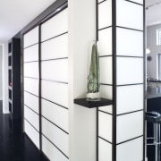 View of kitchen designed by Celia Visser of display case, furniture, product design, shelf, shelving, white