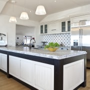 Close-up view of main kitchen area with large cabinetry, countertop, cuisine classique, floor, home, interior design, kitchen, room, white