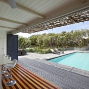 View of the poolside area - View of estate, house, leisure, property, real estate, resort, swimming pool, villa, gray