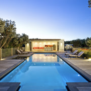 Evening view of the pool area - Evening architecture, backyard, estate, home, house, leisure, property, real estate, reflection, resort, sky, swimming pool, villa, water, teal