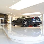 Ferrari Showroom in Australia - Ferrari Showroom in auto show, automotive design, automotive exterior, car, car dealership, luxury vehicle, mid size car, motor vehicle, personal luxury car, vehicle, white
