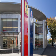 Exterior view of the entrance to the Ferrari architecture, building, city, commercial building, corporate headquarters, facade, metropolitan area, mixed use, real estate, gray