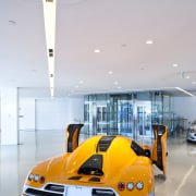 Ferrari Showroom - Ferrari Showroom - automotive design automotive design, car, motor vehicle, sports car, vehicle, yellow, gray