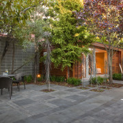View of private courtyard which features native planting, backyard, cottage, courtyard, estate, facade, garden, home, house, landscape, landscaping, outdoor structure, patio, plant, property, real estate, residential area, tree, walkway, yard, brown, gray