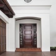 Exterior view of Eden Homes show home which door, estate, facade, property, real estate, window, white, red