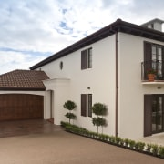 Exterior view of Eden Homes show home which building, elevation, estate, facade, home, house, property, real estate, residential area, roof, villa, window, brown, gray