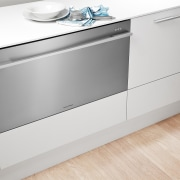 View of kitchen featuring appliances from Fisher & angle, chest of drawers, countertop, drawer, floor, furniture, home appliance, kitchen, major appliance, product, product design, sideboard, white