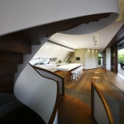 View of the spiral stairway in this contemporary architecture, daylighting, furniture, house, interior design, product design, stairs, table, black, gray