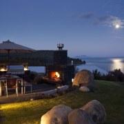 Evening view of the contemporary home - Evening cottage, dusk, estate, evening, home, horizon, lighting, property, real estate, resort, sea, sky, villa, blue, black