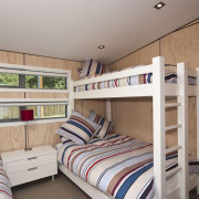 View of the children's room - View of bed, bedroom, bunk bed, furniture, real estate, room, gray