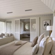 Interior view of a light-toned beach house. - bedroom, ceiling, estate, floor, home, interior design, real estate, room, suite, window, window covering, gray