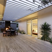 Overview of sheltered outdoor area of this modern courtyard, deck, estate, home, house, interior design, outdoor structure, patio, property, real estate, roof, gray