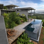 View of modern home designed by Design Unit architecture, backyard, cottage, home, house, outdoor structure, property, real estate, roof, brown