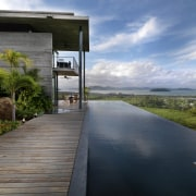 View of modern home designed by Design Unit architecture, cottage, estate, home, house, landscape, property, real estate, reflection, sky, walkway, water, gray