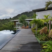 View of modern home designed by Design Unit arecales, cottage, estate, home, house, landscape, property, real estate, resort, villa, walkway, water, gray