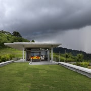View of modern home designed by Design Unit architecture, cloud, estate, grass, home, house, landscape, plant, real estate, roof, sky, gray, brown