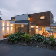 Evening view of contemporary home with gardens, exterior architecture, elevation, estate, facade, home, house, property, real estate, residential area, gray, black