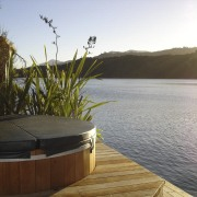 View of spa tub that is situated right reflection, sky, water, white
