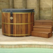 View of the traditional tub which has a barrel, wood, wood stain, brown
