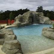 View of the pool area which has a fountain, leisure, swimming pool, water, water feature, water resources, watercourse, waterfall, brown