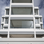 Exterior view of apartment building which features balconies architecture, building, elevation, facade, glass, home, house, window, gray, white