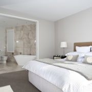 View of the master suite which features a architecture, bed frame, bedroom, ceiling, floor, home, interior design, property, real estate, room, suite, wall, gray, white