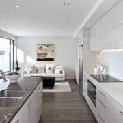 View of kitchen area which features island, granite architecture, countertop, interior design, kitchen, real estate, gray, white