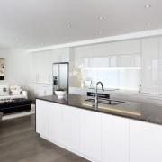 View of kitchen area which features island, granite countertop, cuisine classique, floor, interior design, kitchen, property, real estate, room, white, gray
