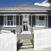 View of this modern home - View of building, estate, facade, fence, home, house, neighbourhood, picket fence, property, real estate, residential area, white