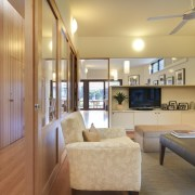 View of this contemporary remodeled lounge area - ceiling, floor, interior design, living room, real estate, room, orange