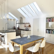 View of renovated kitchen which features timber floors, dining room, interior design, kitchen, real estate, room, table, white