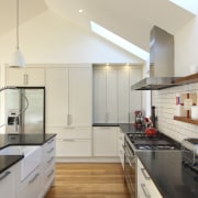 View of renovated kitchen which features timber floors, countertop, cuisine classique, interior design, kitchen, real estate, gray
