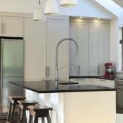 View of renovated kitchen which features timber floors, countertop, home, interior design, kitchen, light fixture, product design, table, gray