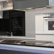 View of a contemporary kitchen area - View countertop, fireplace, home appliance, kitchen, kitchen appliance, kitchen stove, product design, gray, black