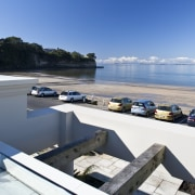 View of the exterior of this modern home sea, sky, water, white, teal