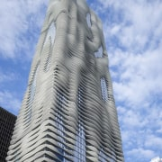 Exterior view of the Aqua Tower in Chicago architecture, building, cloud, condominium, corporate headquarters, daytime, landmark, metropolis, metropolitan area, sky, skyscraper, tower, tower block, urban area, teal, gray