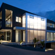 Exterior view of this contemporary home - Exterior apartment, architecture, building, commercial building, condominium, corporate headquarters, elevation, estate, facade, home, house, mixed use, property, real estate, residential area, sky, window, blue
