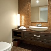 Interior view of this modern home - Interior bathroom, floor, flooring, home, interior design, room, sink, tile, wall, wood flooring, brown, orange