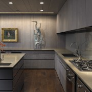 View of this contemporary apartment that has been cabinetry, countertop, interior design, kitchen, room, under cabinet lighting, black, gray