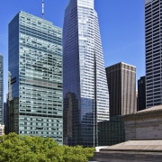 View of the Bank of America Tower in architecture, building, city, cityscape, condominium, corporate headquarters, daytime, downtown, headquarters, landmark, metropolis, metropolitan area, sky, skyline, skyscraper, tower, tower block, urban area, blue, black