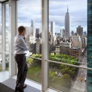 Interior view of windows overlooking Manhattan in the building, city, condominium, glass, reflection, skyscraper, tower block, urban area, window, gray, white