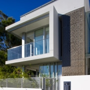 Exterior view of town house featuring cantilevered balconies architecture, building, commercial building, elevation, facade, home, house, property, real estate, residential area, window, blue, white
