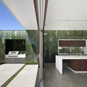 View of a contemporary kitchen which features island, architecture, daylighting, house, interior design, real estate, white