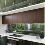 View of a contemporary kitchen which features island, architecture, house, interior design, window, white
