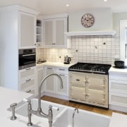 View of a traditional-styled kitchen which features a cabinetry, countertop, cuisine classique, home appliance, interior design, kitchen, kitchen stove, room, gray