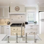 View of a traditional-styled kitchen which features a cabinetry, countertop, cuisine classique, interior design, kitchen, room, gray