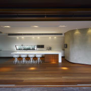 View of kitchen area featuring hardwood flooring, island architecture, door, floor, flooring, hardwood, home, house, interior design, property, real estate, window, black
